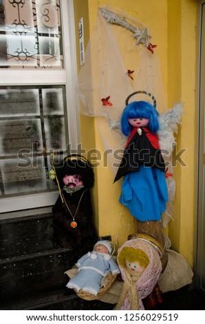 Dolls representing the nativity scene (the child Jesus, Mary, Joseph and one angel). Schamann. Las Palmas de Gran Canaria. Gran Canaria. Spain. #1256029519