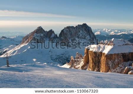 Dolomite Alps, South Tirol, Italy: Snow-covered mountain peaks in the evening sun with blue sky