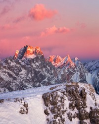 Dolomites. Winter mountains. Sunset. Enrosadira effect. Snow mountains. The peak of mount Pelmo, postcard view, Alps.