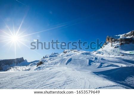Dolomities Dolomiti Italy in wintertime beautiful alps winter mountains and ski slope Cortina d'Ampezzo Cinque torri mountain peaks famous landscape skiing resort area Foto stock ©