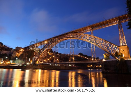 Dom Luis I Bridge illuminated at night. Oporto, Portugal