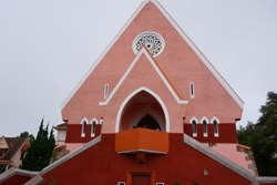 Domain de Marie Church in Da Lat Lam Dong Vietnam Pink church selling woolen sweater and hat with flowers pot