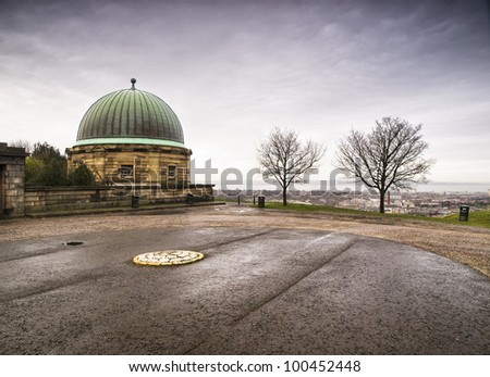 Dome building in Edinburgh. There are two leafless trees and the sky is overcast.