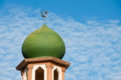 Dome of mosque in blue sky
