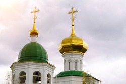dome of the church in Russia with a cross. Cross on the dome of the Orthodox church