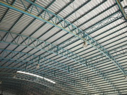 Dome roof steel structure. It is equipped with a roofing metal sheet and a shaded roof of the stadium or indoor multipurpose yard. Selective focus