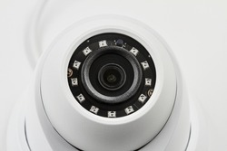 Dome secure camera on light background with motion sensors. Video surveillance camera. Closeup, selective focus