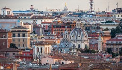 Domes of churches and roofs of houses in Rome at sunrise
