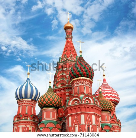 Domes of the famous Head of St. Basil's Cathedral over cloudy sky