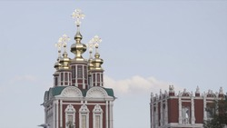 Domes with crosses of Russian churches on background sky. Action. Beautiful architecture of Russian churches with Golden domes and crosses. Religious architecture