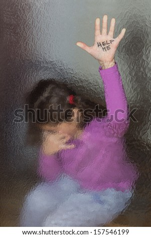 Domestic and family violence. Little girl asking for help. Look through the glass.