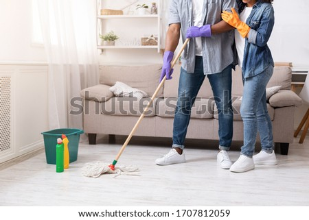 Photo of Domestic Duties. Unrecognizable African American Couple Mopping Floor Together, Doing Spring-Cleaning At Home, Cropped Image With Free Space
