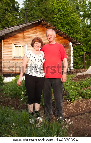 domestic elderly pair on nature by a sunny canicular day