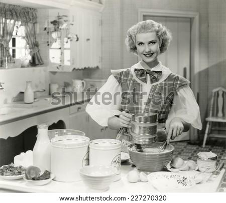 Domestic goddess baking in the kitchen