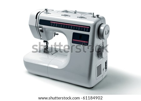 Domestic sewing machine on white background