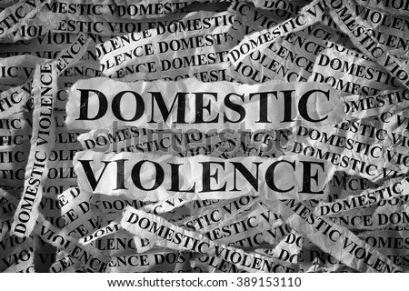 Domestic violence. Torn pieces of paper with the words Domestic violence. Concept Image. Black and White. Closeup. #389153110