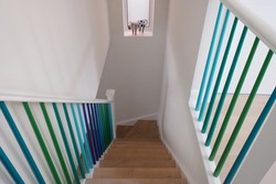 Domestic wooden staircase, with spindles painted in ombre colours