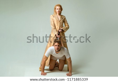 Dominantning in the foreplay sexual game. Woman and man playing domination games. Love relations and dominating. Concept of sexual domination or bondage. Dominant womans.