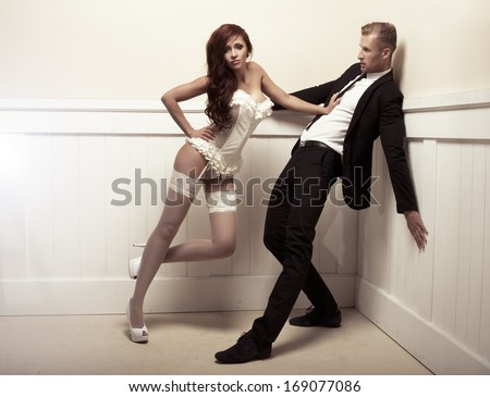 Dominating woman and handsome man  - stock photo