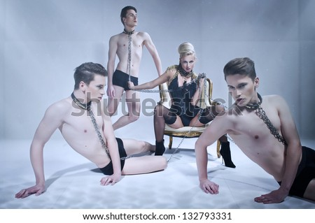 Dominating woman and handsome men - stock photo
