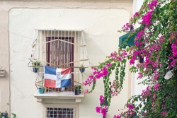 Dominican Republic, flag on the balcony, flowers bloom
