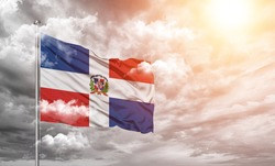 Dominican Republic  national flag cloth fabric on cloud background
