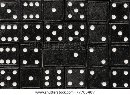 Domino cards fill a table. Rectangle of dominoes tilled on a table