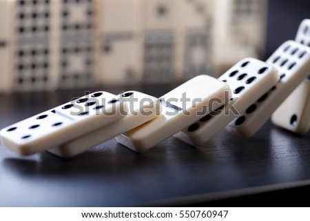 Domino effect shot on black background  #550760947