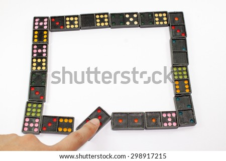 Domino effect. The Falling Domino Prinsiple. The Domino principle. The game of dominoes.