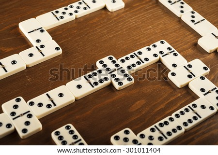 domino game tiles on wooden table