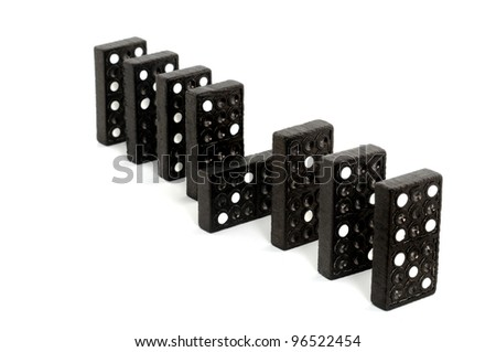 Domino pieces in a row in front of a white background