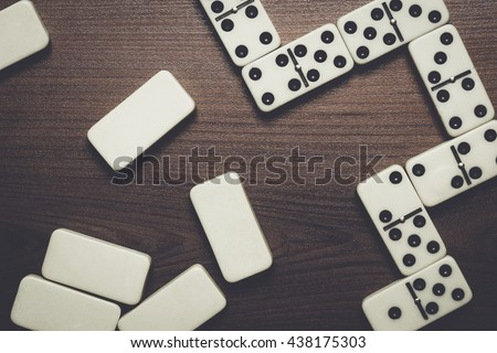 domino pieces on the brown...