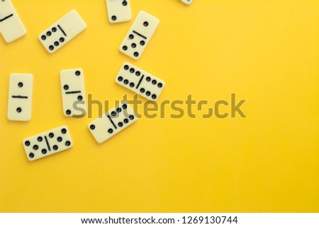 domino pieces on yellow background