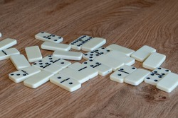 Dominoes are randomly scattered on the table