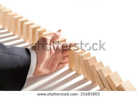 dominoes isolated on white as an abstract management concept