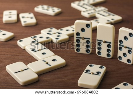 dominoes on a wooden table. the ...