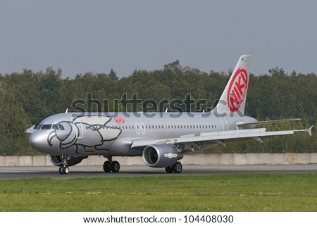 DOMODEDOVO, RUSSIA - SEPTEMBER 1: Aircraft operated by Flyniki, taxis at Moscow airport in Domodedovo on September 01, 2011. The company in its fleet has 11 Airbus aircraft A319
