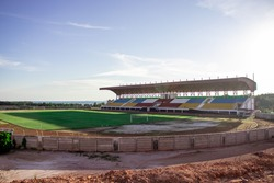 Dompak stadium under construction and completion, photographed with sun flares