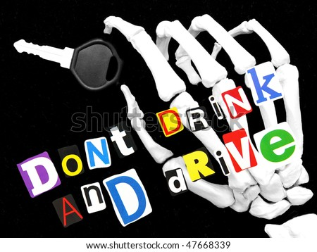 don't drink and drive - skeletal hand holding a car key