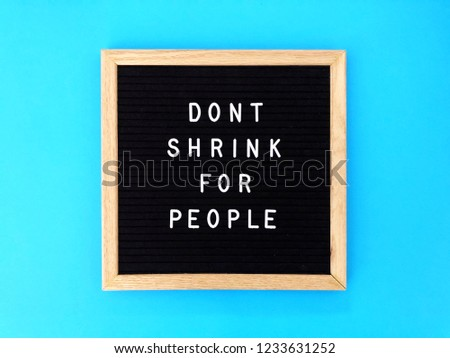 Don't shrink for people. Great quote on black message board. Blue background.