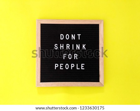 Don't shrink for people. Great quote on black message board. Bright yellow background.