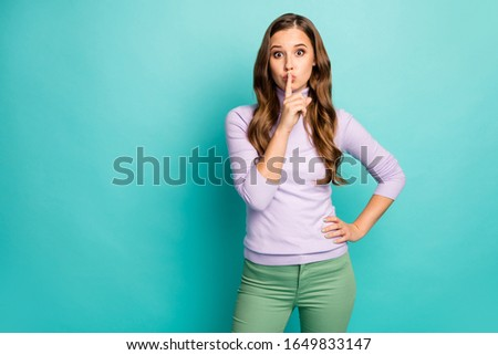 Don't speak. Photo of beautiful pretty lady long wavy hairdo holding finger on lips ask keep silence wear purple pullover green pants isolated teal pastel blue color background