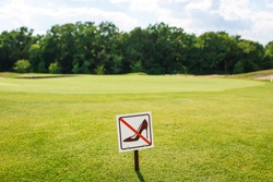 Don't walk on the grass sign. Sign board on the park lawn Do not walk on the Grass.