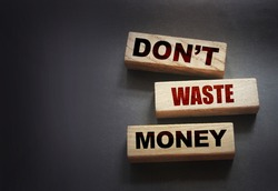 Don't waste money on wooden blocks. Personal finance concept.