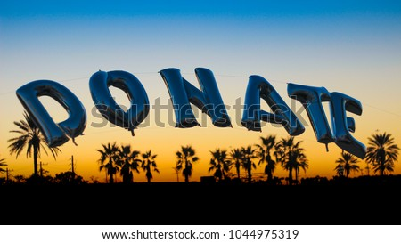 Donate balloon sign at charities and fundraiser event #1044975319