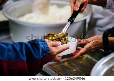 Photo of  Donate food to hungry people, Concept of poverty and hunger
