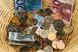 Donation basket for collection.  Donate money with Euro