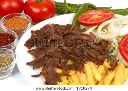 doner kebap with french fries and salads