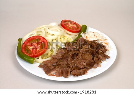 Doner kebap with rice and salads