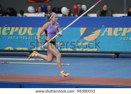 DONETSK, UKRAINE - FEB.11: Ptacnikova Jirina - czech pole vaulter, wins first place with National Record 4.70 on Samsung Pole Vault Stars meeting on February 11, 2012 in Donetsk, Ukraine.